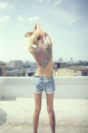 Back tattoo and sky