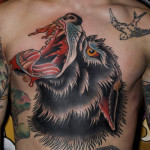 Bloody Wolf on chest traditional tattoo