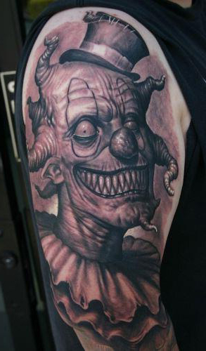 creepy evil clown tattoo on shoulder best tattoo ideas gallery. Black Bedroom Furniture Sets. Home Design Ideas