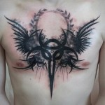 Demonic chest tribal tattoo