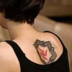 Dot Work Back Swastics tattoo