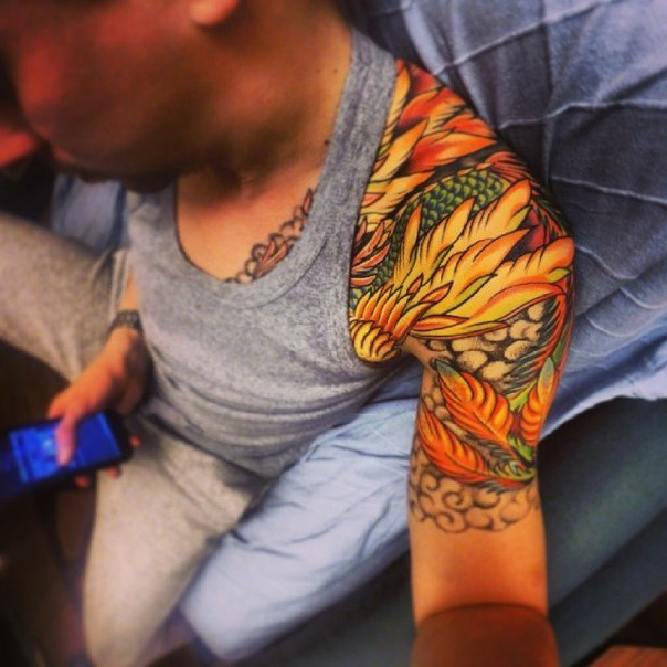 Fire Feather Hand and Shoulder tattoo