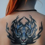 Flame blue tiger back tribal tattoo