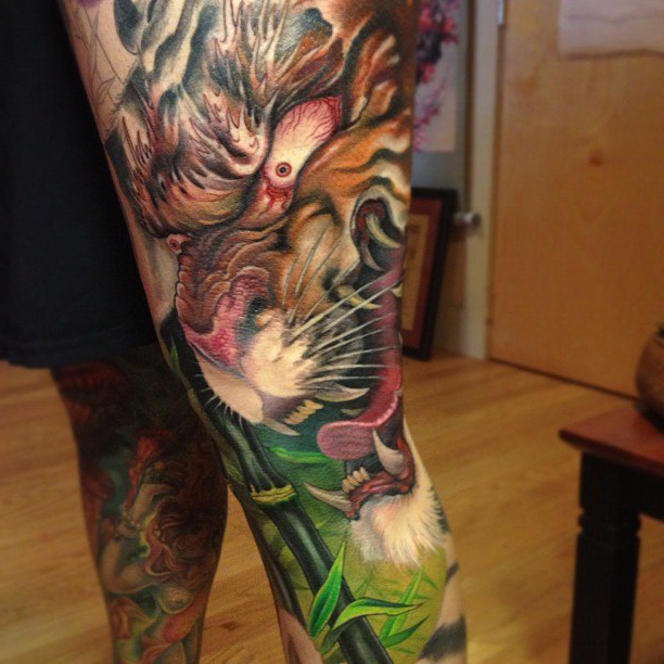 Furious tiger japanese tattoo on leg best tattoo ideas for Tiger thigh tattoos