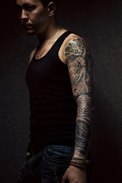 Graphic Suspense tattoo sleeve idea for men