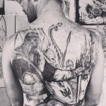 Graphic Viking Warriors Squad tattoo on back