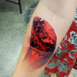Hand Huge Ruby realistic tattoo