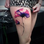Hip Dark flower tattoo