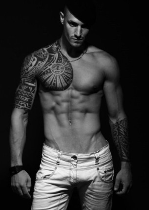 Maori sun on heart tattoo picture for men