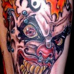 Pierced Inked Evil Clown tattoo
