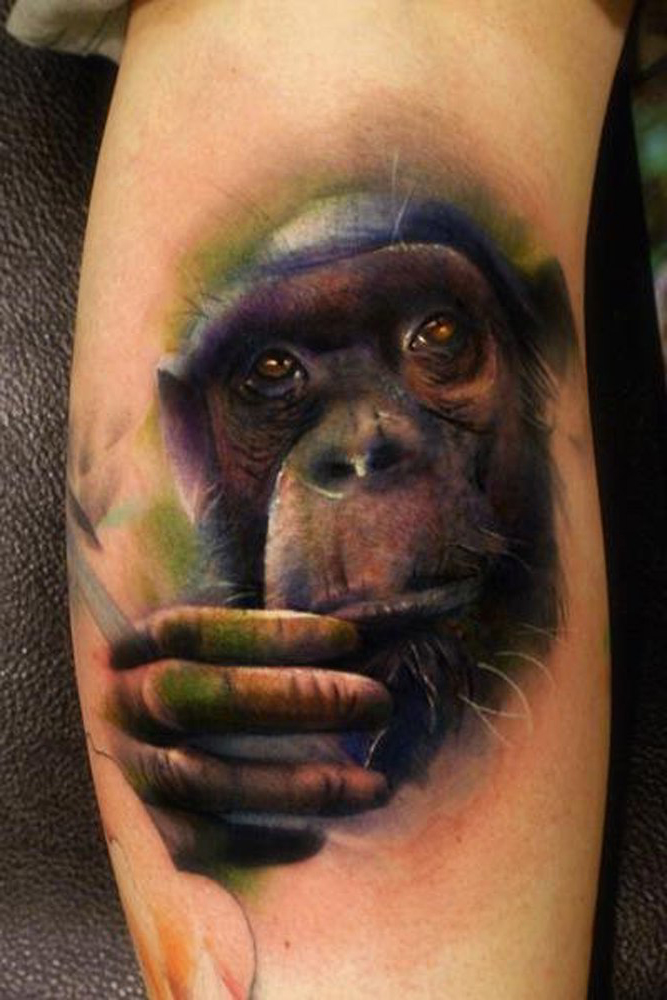 Sad Chimp realistic tattoo