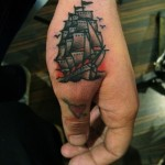 Sailing Frigate near thumb tattoo