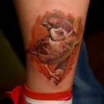 Sparrow on a Brunch realistic tattoo on leg