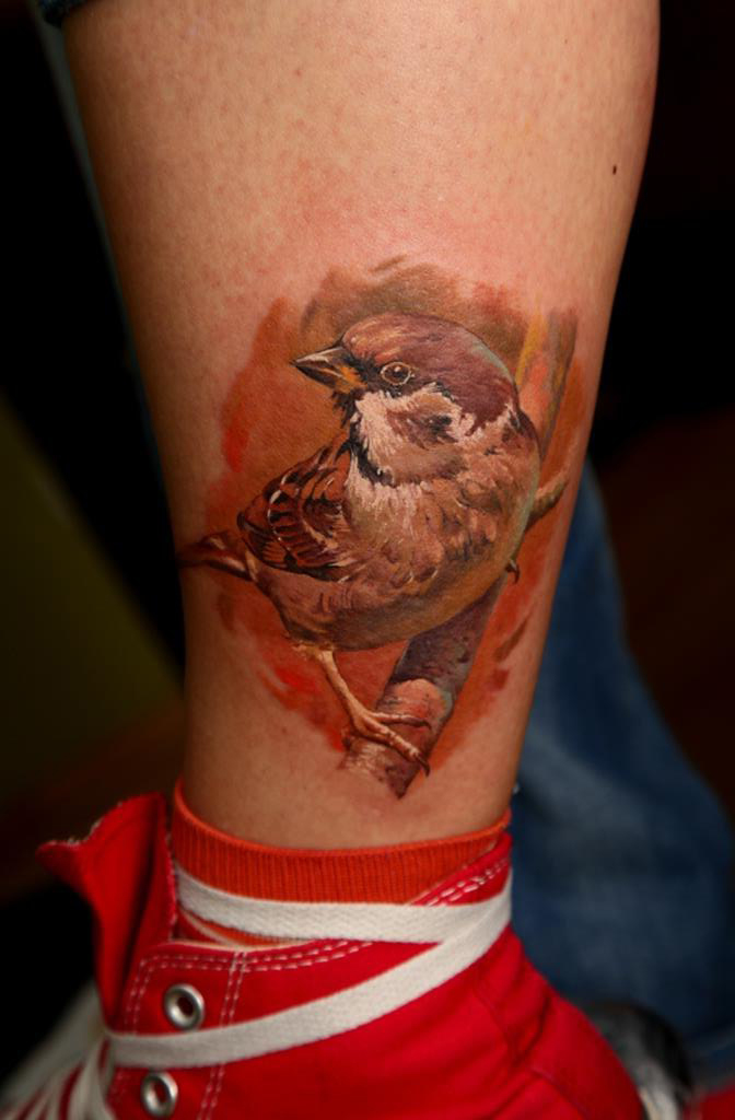 Sparrow on a Brunch realistic tattoo on leg