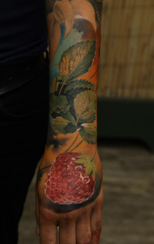 Strawberry sleeve realistic tattoo