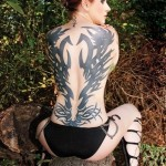 The whole back girl tribal tattoo