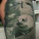 Water Glade Seal realistic tattoo on hip