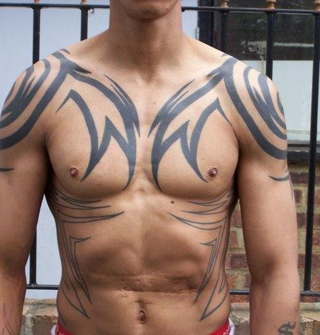 Tribal tattoo on shoulder, belly and chest