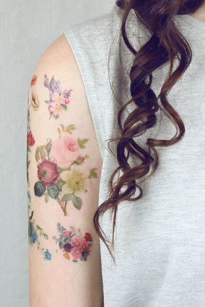 A lot of Little Aquarelle Flower Tattoo on Shoulder