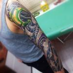 Alien Living Robotic Hand Organic tattoo idea