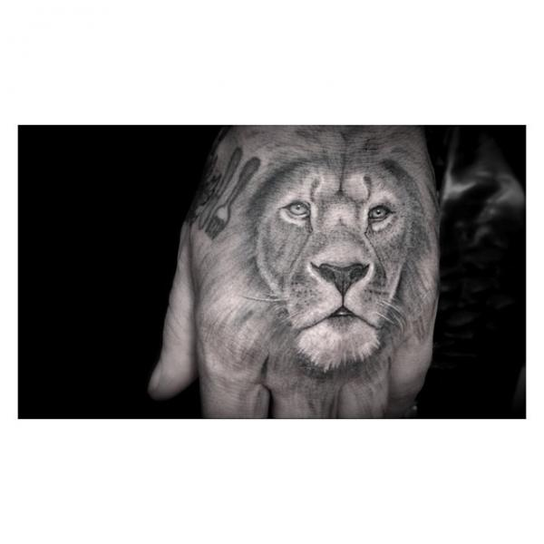 Back of the Hand Realistic Lion tattoo by Dr Woo