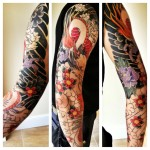 Black Wings and Fire Bird Dragon tattoo sleeve