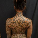 Circle Centered Full Back Tribal tattoo