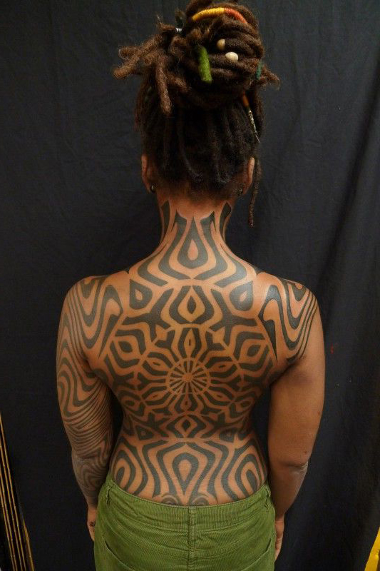Circle centered full back tribal tattoo for Back tribal tattoo