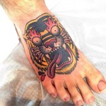 Crazy Fire Eyes Tiger tattoo by Chopstick Tattoo