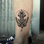 Dotwork Symbolic Flower tattoo on leg