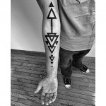 Down arrows Blackwork tattoo
