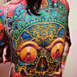 Ethnic Skull New School tattoo idea on Back