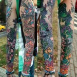 Evil Alice in Wonderland tattoo sleeve by Aleksei GloBuS Berezniov