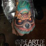 Evil Owl hand tattoo by The Art of London