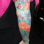 Field Flowers and Ladybug tattoo sleeve