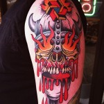 Fire Eyes Viking Skull New School tattoo on Shoulder