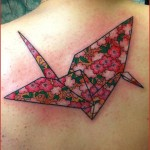 Flower Origami tattoo on back by Chapel tattoo