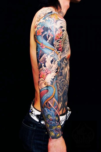 Flowers and Snake Dragon tattoo sleeve