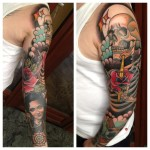 Golden Dagger in Rose and Skull tattoo sleeve