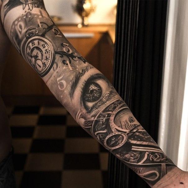 Graphic Clocks and Eye tattoo sleeve