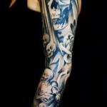 Graphic Death and Skulls tattoo sleeve