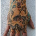 Hand Skull tattoo by White Rabbit Tattoo