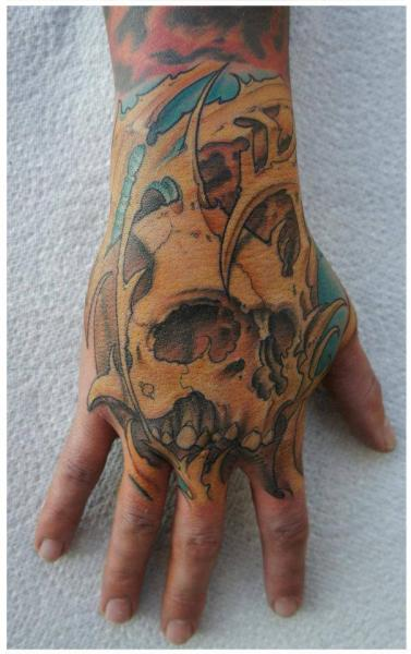 Hand Scull tattoo by White Rabbit Tattoo