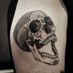 Latin Skull Graphic tattoo idea