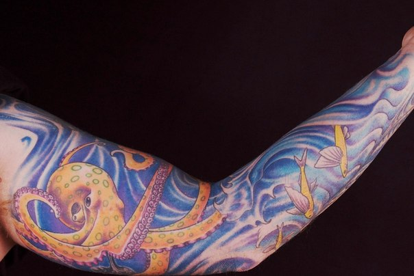 Nautical tattoo sleeve of octopus and flying fishes