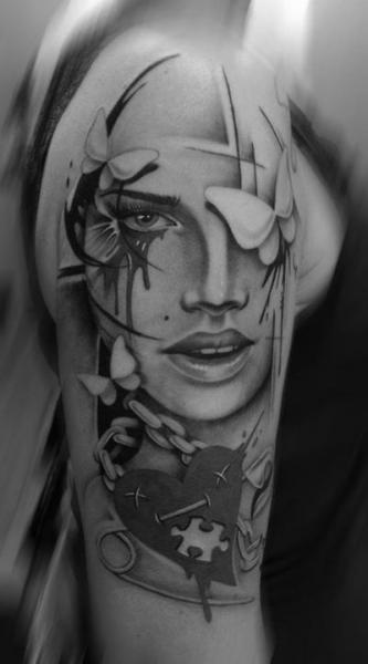 Puzzle Heart Face Realistic tattoo by Westfall Tattoo