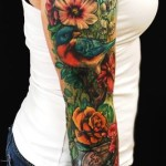 Realistic Flowers Bird and Clock tattoo sleeve