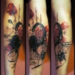 Realistic Hedphones Trash Polka tattoo by White Rabbit Tattoo