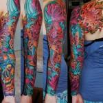 Red Fish and Demon Teeth tattoo sleeve