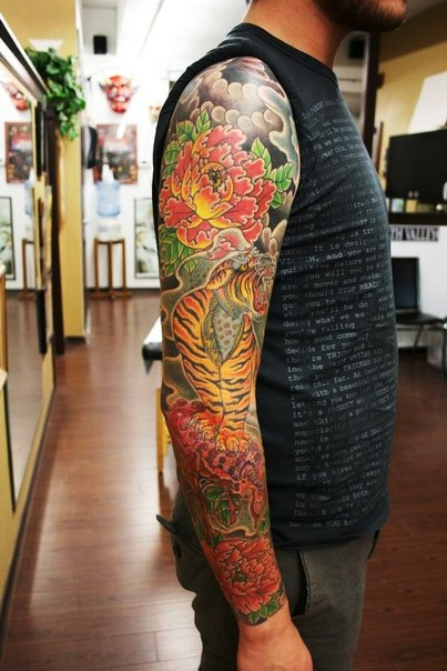 Red Flowers and Growling Tiger Japanese tattoo sleeve